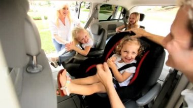 Young parents preparing children road trip
