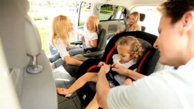 Happy Caucasian parents children family car