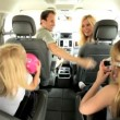 Stock Video: Young Caucasian Family in Car Beach Trip
