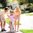 Cute Blonde Girl Practicing Bike Riding - Stock Photo
