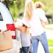 Young Caucasian Family Packing Car Before Outing - Stock Photo