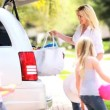 Stock Video: Cute Girls Parents Getting Family Car Ready Car Journey
