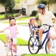 Healthy Lifestyle Cycling of Young Caucasian Family — Stok Video #17634483