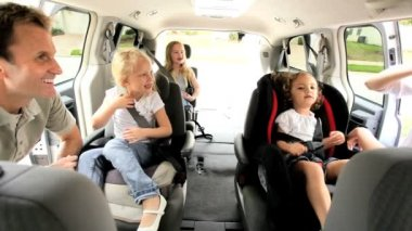 Parents children preparing for road trip in family car