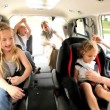 Blonde Caucasian Family Ready Car Road Trip - Stock Photo