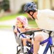 Young Father and Toddler Safety Helmets Bicycle - Stock Photo