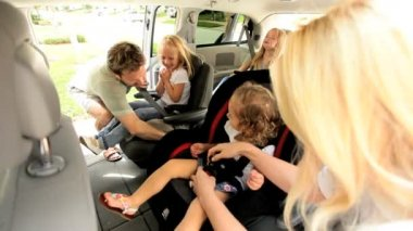 Caucasian parents children preparing shopping trip family car