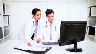 Latin American Hospital Consultants Working Computer — Stock Video