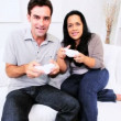 Hispanic Couple Playing Games Console  — Stock Video