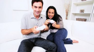 Ethnic Couple Playing Electronic Games — Stok video