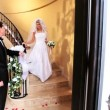 Father Watching Bride Descend Staircase - Foto Stock