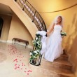 Stock Video: Blonde Bride Wedding Dress Descending Staircase
