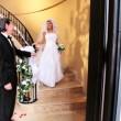 Stock Video: Father of Bride Watching her on Marble Staircase