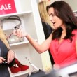 Caucasian Store Assistant with Female Shopper - Stock Photo
