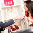Fashion Outlet Assistant with Female Shopper - Lizenzfreies Foto