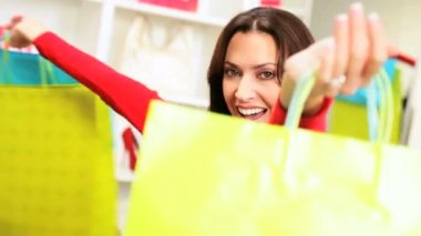 Close up brunette female with designer bags successful days shopping
