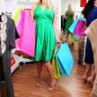 Female Friends Choosing Clothes Chic Boutique — Stock Video