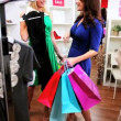 Fashionable Girlfriends Shopping Chic Boutique - Stock Photo