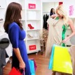 Female Friends Browsing Exclusive Clothing Store — Video Stock