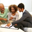 Female Business Advisor Home Meeting Elderly Couple - Stock Photo