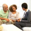 Financial Expert Home Meeting Retired Couple - Foto Stock