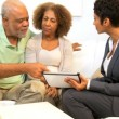 Elderly Couple Meeting Financial Advisor Home - Stock Photo
