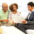 Saleswoman Home Meeting Senior Couple - Stock Photo
