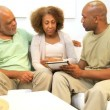 African American Son and Parents Wireless Tablet Technology - Stock Photo