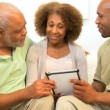 African American Family Wireless Tablet Technology - Stock Photo