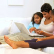 African American Mother Daughters Internet Home Shopping - ストック写真