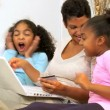 African American Mother Girls Online Shopping - Stock Photo