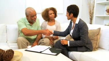 Older Ethnic Couple Meeting Financial Advisor Home — Stock Video
