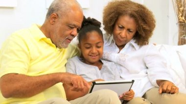 African American Grandparents Grandchild Home Wireless Tablet — Stock Video