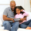 Lone Ethnic Parent Family Wireless Home Technology - Stock Photo