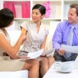 Stock Video: Female Asian Chinese Advertising Executive Multi Ethnic Team
