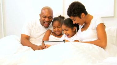 African American Children Parents Playing Bed Wireless Technology — Stock Video