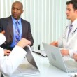 Hospital Doctors Meeting Financial Consultant - Stock Photo