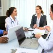 Multi Ethnic Medical Team Meeting with Financial Advisor - Stock Photo
