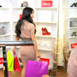 Stock Video: Girlfriends Shopping Chic Boutique
