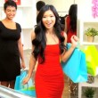 Female Friends Choosing Accessories Chic Boutique - Stock Photo