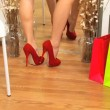 Trying Red Stiletto Shoes for Size - Foto Stock
