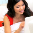 Close up Ethnic Female Laptop Home Sofa - Stock fotografie