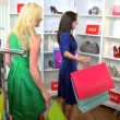 Vídeo Stock: Girlfriends Shopping Chic Boutique