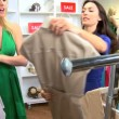 Female Friends Browsing Exclusive Clothing Store — Stock Video