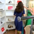 Stok video: Female Friends Shopping Chic Boutique