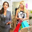 Stock Video: Fashion Outlet Assistant with Female Shopper
