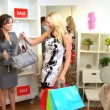Boutique Manager Helping Fashion Conscious Client — Stockvideo