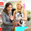 Stock Video: Boutique Client Viewing Online Fashion Collection