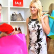 Boutique Owner With Fashionable Client  — Stockvideo