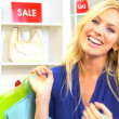 Blonde Woman Shopping Trip Bags - Stock Photo